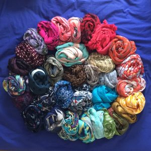 Arranging scarves in a wheel by DECLUTR, professional organiser in Canberra